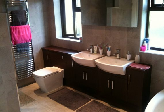 Twin sink in designed bathroom