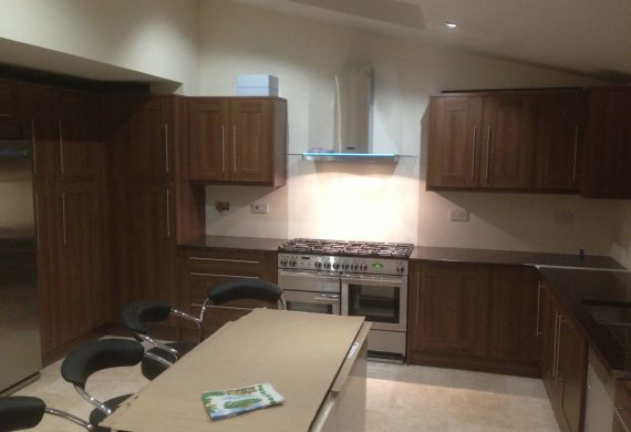 Kitchen cupboards, new range and extractor